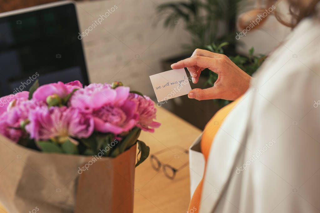 Tender female hands holding present card