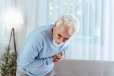 Ill senior man feeling pain in chest