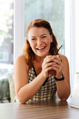 Happy mature woman laughing while communicating with husband