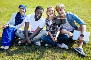 International students taking selfies outdoors