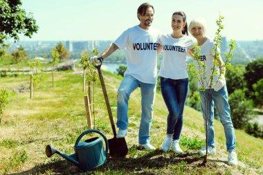 Group of volunteers standing near new plants