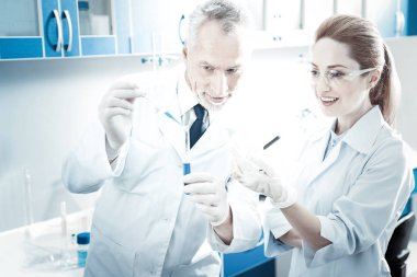 Positive professional scientists working in the lab together