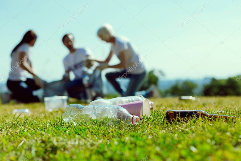 Focused photo on plastic bottles that being on grass