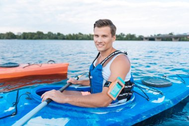 Active businessman spending his day off kayaking