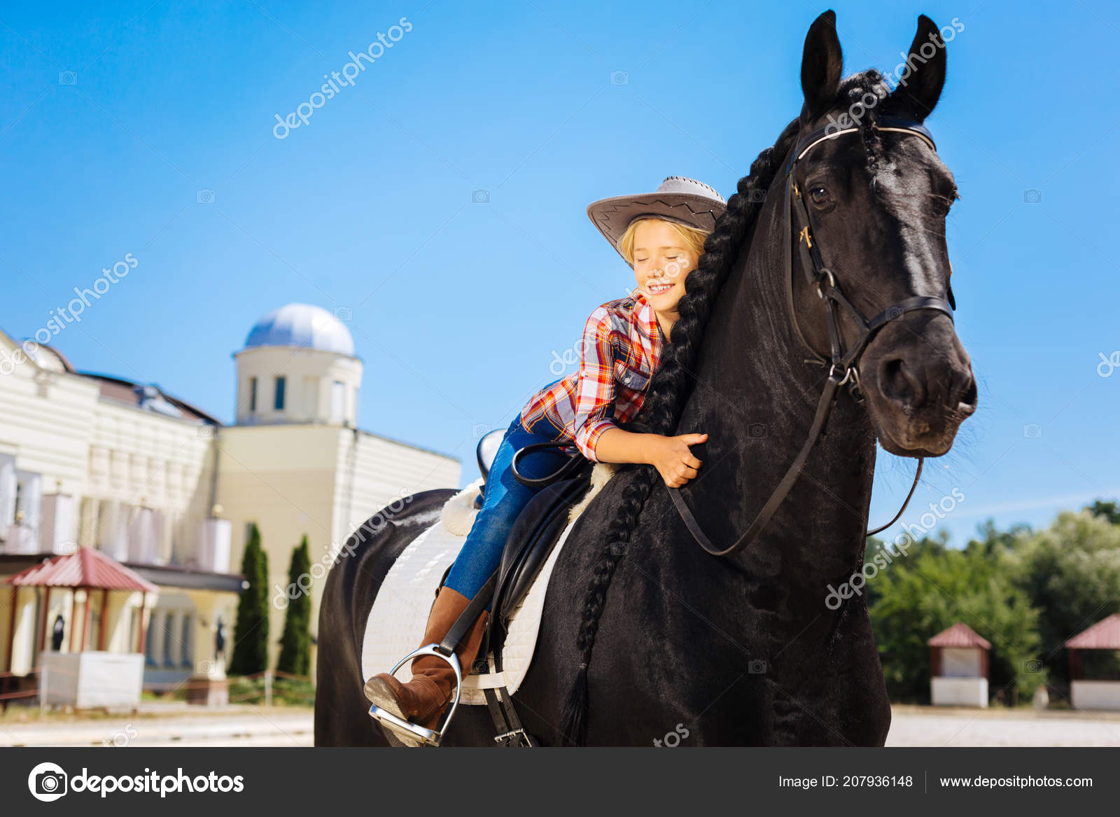 Černé dospívající na koni