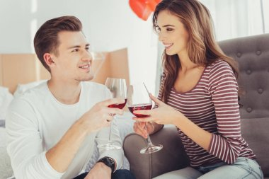 Portrait of charming lovers drinking wine