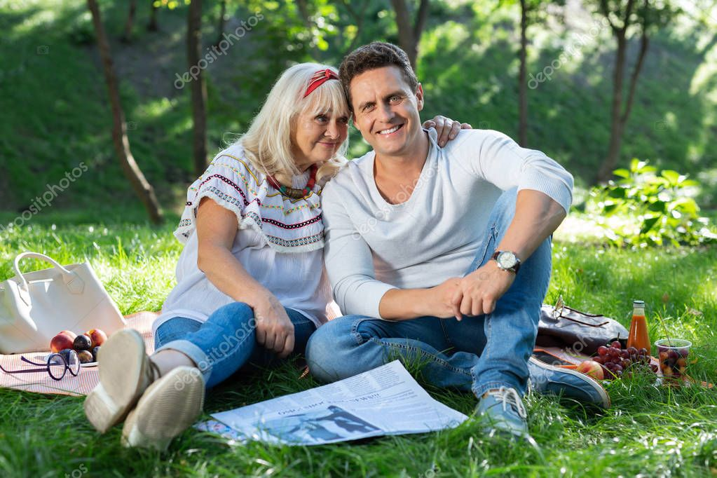Attractive female person sitting near young man