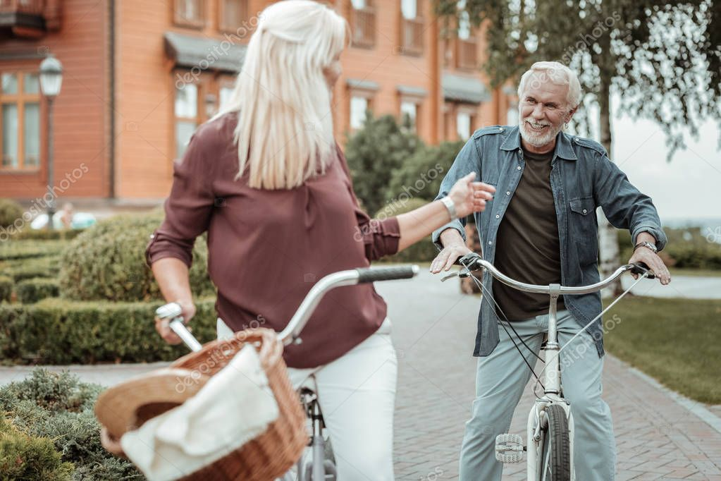 Positive delighted mature people having active life