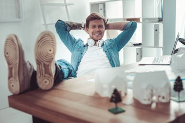 Positive delighted young man having pause