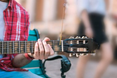 Professional street musician challenging himself in music