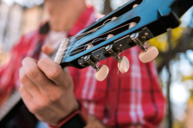 Talented street musician placing hand on strings