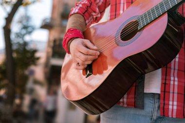 Young street musician relishing music on street