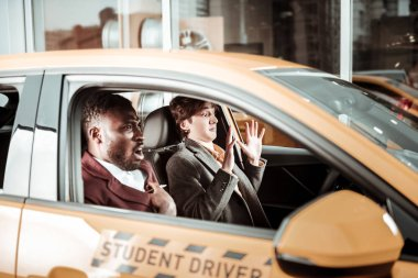 Driving instructor feeling unsatisfied with parking of his student