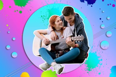 Young couple sitting against the colorful background and playing the guitar