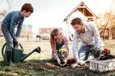 Father with his children laughing during gardening