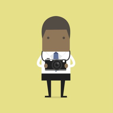 African businessman holding a camera.