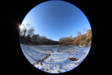 Frozen river in forest. Circular fisheye landscape