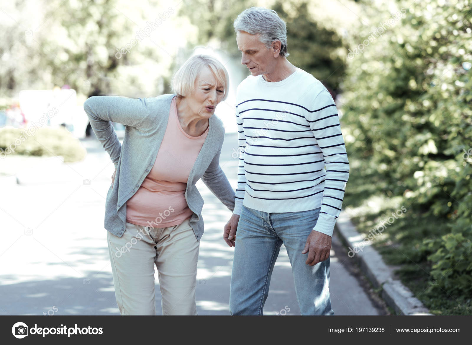 Mature woman having pain in back — Stock Photo
