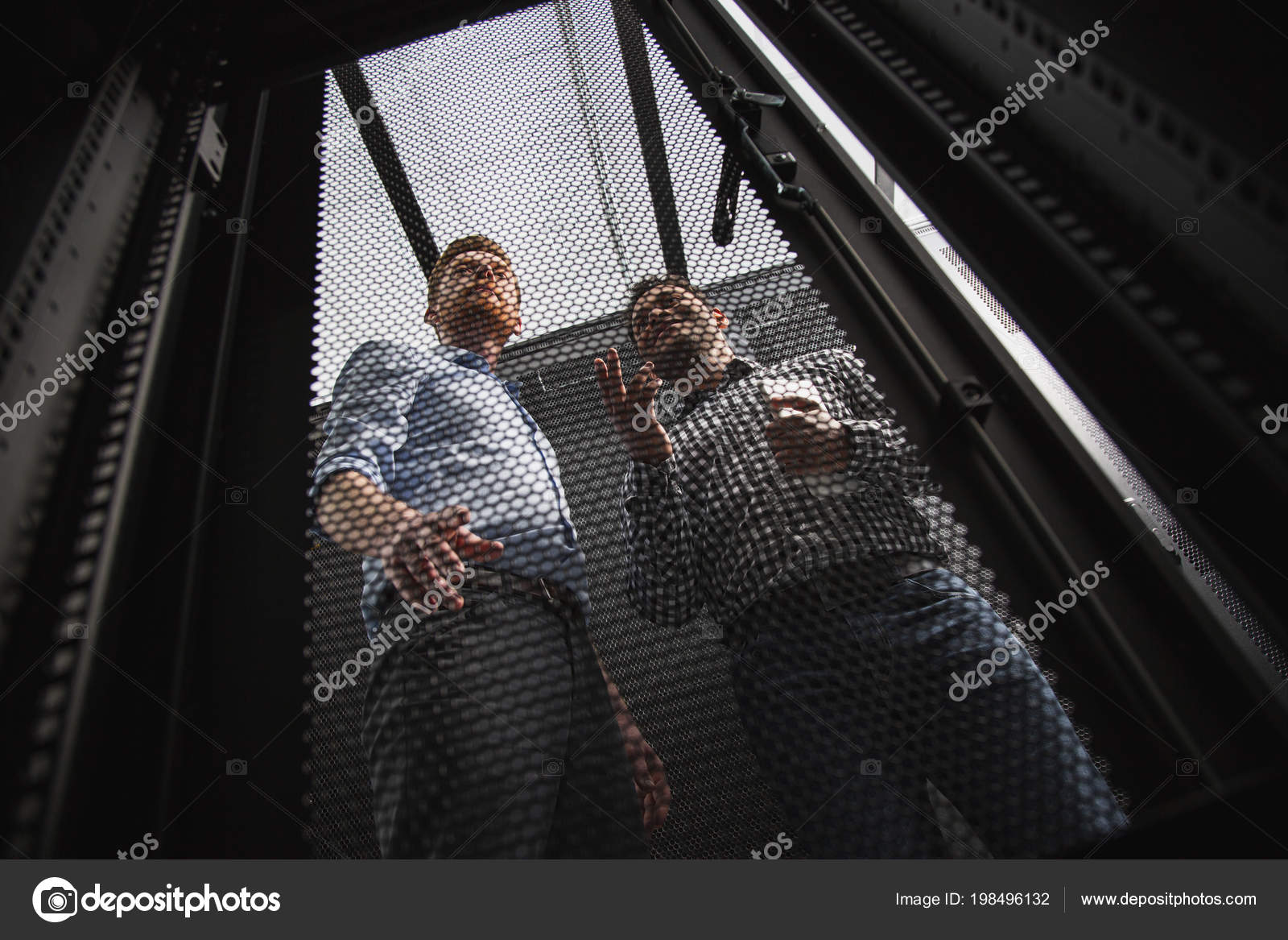 Pleased Two Colleagues Examining Server Closet U2014 Stock Photo