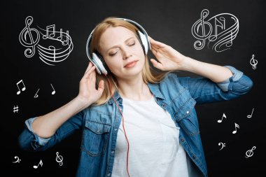 Peaceful music. Relaxed young woman standing with her eyes closed and feeling good while listening to music stock vector