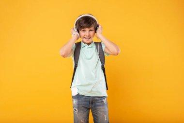 Alert schoolboy listening to music