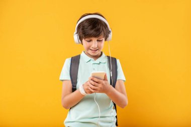 Content schoolboy listening to music