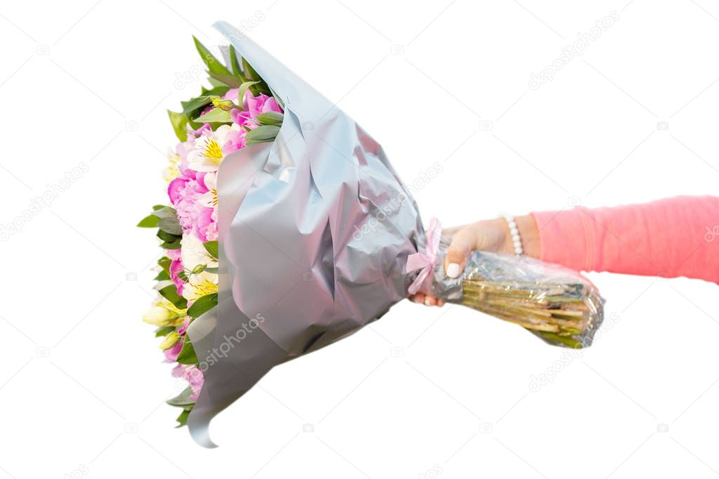 Female hand holding bouquet of flowers horizontally