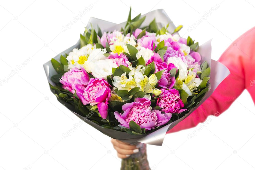 Pretty flowers being arranged in a bouquet