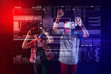 Emotional kids feeling impressed while wearing virtual reality glasses