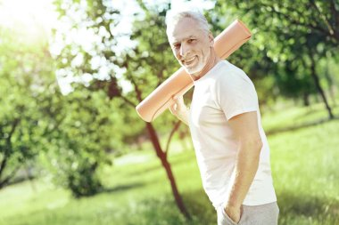 Active pensioner spending his free time in a park