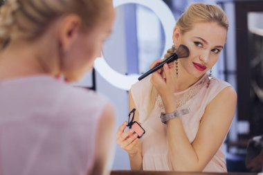 Gorgeous businesswoman getting ready for exciting date