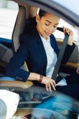 Positive young woman driving safe