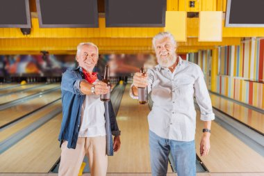 Nice joyful elderly men looking at you