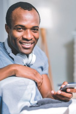 Good-looking man holding a mobile phone