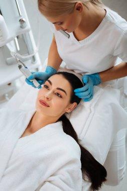 Nice pleasant woman having a beauty procedure