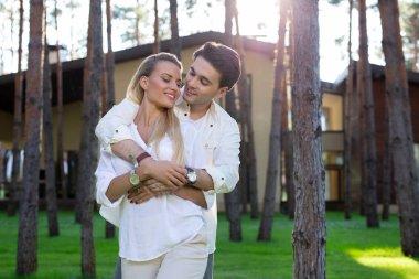 Pleasurable weekend. Joyful happy couple standing together while enjoying their weekend stock vector