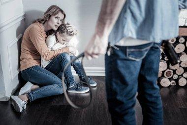 Inadequate man punishing his family