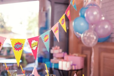 Beautiful photo of colorful party flags placed in the room