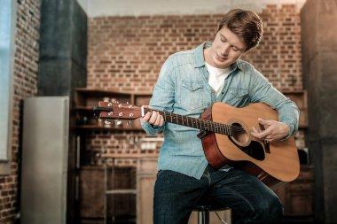 Nice young man playing the guitar