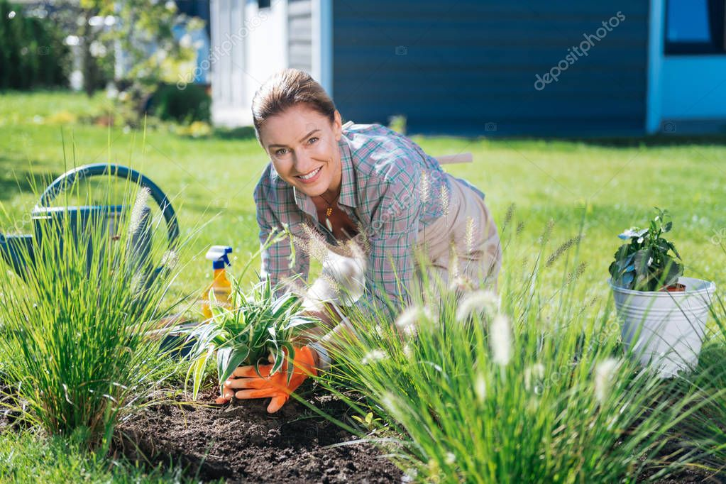 Great supporter of clean environment spending her morning near flower bed