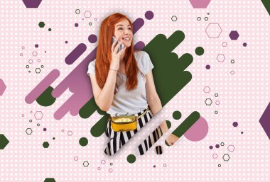 Colorful background. Cheerful red-haired student wearing stylish clothes standing ahead of colorful graphic background