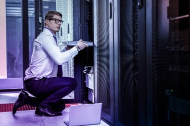 Nice smart young man stealing the database