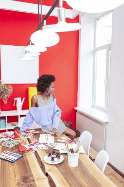 Designer enjoying her day while working in big creative office