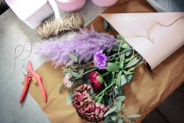 Top view of flowers that lying on table