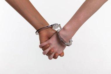 Desperate little kids covered in metal handcuffs binding fingers