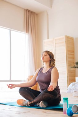 Beautiful peaceful fit woman trying to meditate