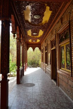 Ancient style corridor with beautiful wooden carving in the weal