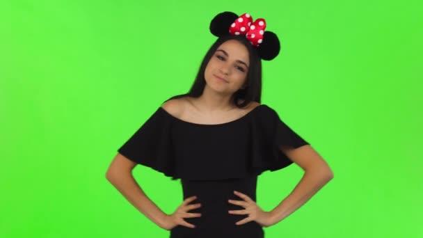 Beautiful woman wearing fluffy mouse ears posing playfully