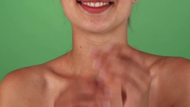 Stunning happy woman smiling and cupping her face with her hands