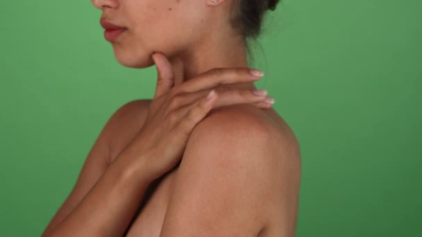 Young woman touching her shoulder sensually